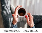 Woman Holding A Hot Cup Of...