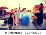 group of young people sitting... | Shutterstock . vector #326742137