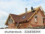 Roofing Construction and Building New Brick House with Modular Chimney, Skylights, Attic, Dormers and Eaves.  - stock photo