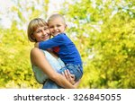 happy mother hugging child son... | Shutterstock . vector #326845055
