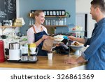 barista serving customer in... | Shutterstock . vector #326861369
