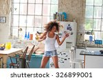 Stock photo sexy brazilian girl dancing at home wearing checked pajamas shorts throwing hair back 326899001