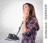 woman talking to vintage phone   Shutterstock . vector #326904239