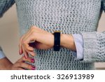 woman in a gray sweater checks... | Shutterstock . vector #326913989
