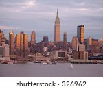 This is a early evening shot of the New York City skyline. - stock photo
