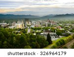 Small photo of The skyline of downtown Asheville, North Carolina at sunset with mountains in the background