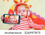 Baby Girl Taking Selfie With A...