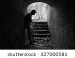 Young Sad Man Stands In Dark...