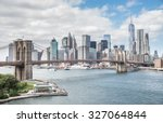 View of Brooklyn Bridge and Manhattan skyline - New York City downtown, photographed from Manhattan Bridge - stock photo