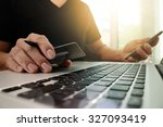 hands using laptop and holding... | Shutterstock . vector #327093419