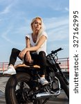 Biker Girl Sitting On Vintage...