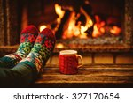 feet in woollen socks by the... | Shutterstock . vector #327170654
