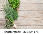 fresh garden herbs on wooden... | Shutterstock . vector #327224171
