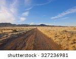 Desert Dirt Road With Beautifu...