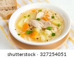 chicken soup with noodles and... | Shutterstock . vector #327254051