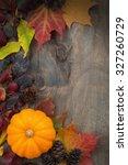 Wooden Background With  Pumpki...
