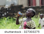 african girl playing with soap... | Shutterstock . vector #327303275