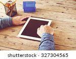 man working at home using a... | Shutterstock . vector #327304565