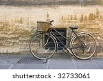 an old bicycle on the street ... | Shutterstock . vector #32733061