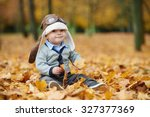 little cute boy in helmet pilot ... | Shutterstock . vector #327377369