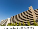 blue sky and a large apartment | Shutterstock . vector #327402329