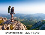 male stand on the rock | Shutterstock . vector #32744149