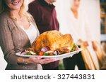 thanksgiving  woman holding...   Shutterstock . vector #327443831