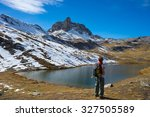hiker looking the outstanding... | Shutterstock . vector #327505589