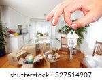 hand with house key. real... | Shutterstock . vector #327514907