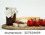 onion jam with cheese   detail | Shutterstock . vector #327524459
