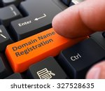 Finger Presses Orange Button ...
