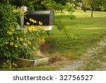 A Black Mailbox In A Rural...