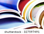 stack of the colorful magazines | Shutterstock . vector #327597491