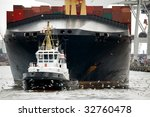 Tugboat Towing Container Ship...