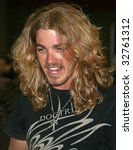 Small photo of NASHVILLE, TN - JUNE 11: Country singer Bucky Covington signs autographs in the Nashville Convention Center during the CMA Festival June 11, 2009 in Nashville, Tennessee.