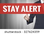 Small photo of Stay Alert word on virtual screen push by business woman red tab