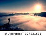 man stands on the peak of... | Shutterstock . vector #327631631