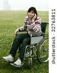 Woman In Wheelchair Talking By...