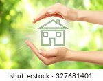 hands holding eco house icon on ... | Shutterstock . vector #327681401