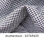 checkered textile closeup. more ...   Shutterstock . vector #32769625