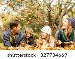 smiling young family throwing... | Shutterstock . vector #327734669