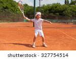 Boy Practicing Tennis Forehand