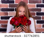 young blond girl smelling the... | Shutterstock . vector #327762851