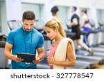 trainer and client discussing... | Shutterstock . vector #327778547