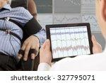 a man passes a lie detector test | Shutterstock . vector #327795071