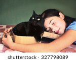 Stock photo teen girl and black cat in cardboard box 327798089
