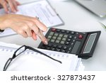 close up of female accountant... | Shutterstock . vector #327873437