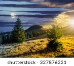 two fir trees on hillside of mountain range with coniferous forest and meadow. composite image day and night with full moon - stock photo