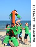Small photo of Vung Tau, Vietnam - June 29, 2015. Unidentified young people in the green uniform playing a team sport game on the beach in Vung Tau, southern Vietnam.