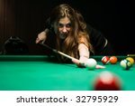 Woman Aiming For The Billiard...